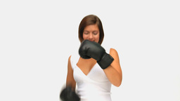 Brownhaired lady with boxing gloves Footage