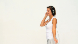 Brunette female dancing with headphones Footage