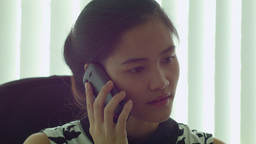 Young Asian Office Worker Talking on the Phone Stock Video Footage