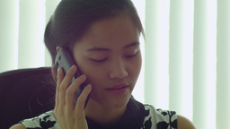 Young Asian Office Worker Talking On The Phone stock footage
