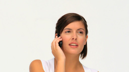 Attrative brownhaired woman having a phone call Footage