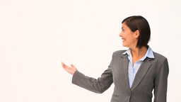 Businesswoman in suit showing us something Stock Video Footage