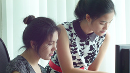 Young Asian Office Workers Working Together at a C Stock Video Footage