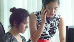 Young Asian Office Workers Working Together at a C Footage