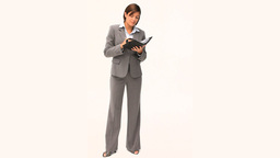 Businesswoman in gray suit taking notes Footage
