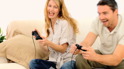 Cute couple playing a video game with with two joy Footage