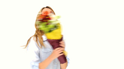 Cute blonde woman with a bunch of flowers Stock Video Footage