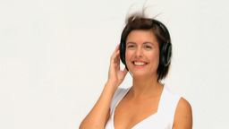 Cute brunette listen to music with headphones Stock Video Footage