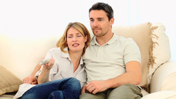 Pretty couple watching tv Stock Video Footage