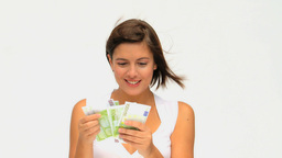 Brownhaired lady counting her cash Footage