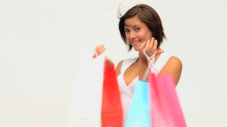 Pretty brunette holding shopping bags Footage