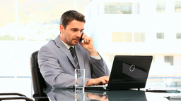 Darkhaired businessman working Stock Video Footage