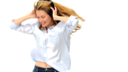 Blond woman dancing with headphones Footage