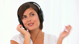 Cute brunette listening to music Footage