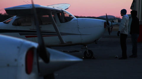Airplane at Sunset, Man is Parking it Footage