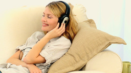 Blond woman listening to music Stock Video Footage