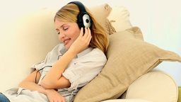 Blond woman listening to music Footage