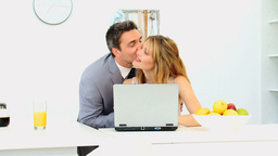 Businessman kissing his wife in the morning Footage