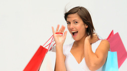 Pretty brunette with shopping bags Footage