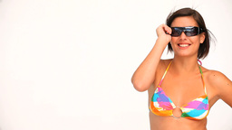 Pretty woman in a swimsuit with sunglasses Footage