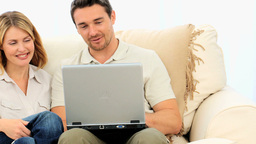 Young couple using a laptop Footage