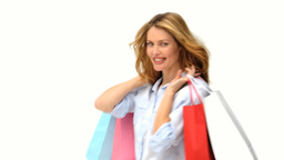 Pretty blonde woman holding shopping bags Footage