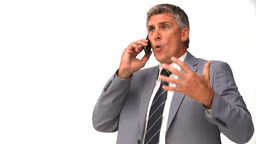 Elderly businessman talking on a smartphone Stock Video Footage