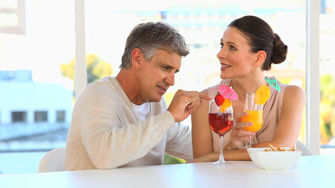 Middle aged couple drinking cocktails Footage