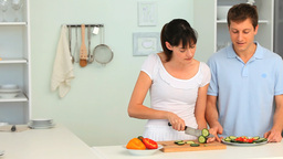 Young couple cooking Stock Video Footage