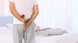 Mature man offering a rose to his wife Stock Video Footage