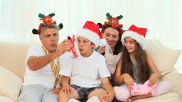Family laughing during the Christmas day Footage