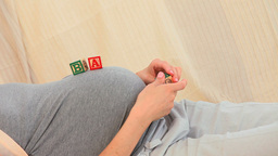 Pregnant woman with building blocks Footage