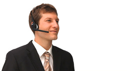 Young businessman with an headset Stock Video Footage