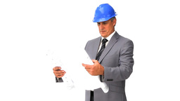 Architect checking his construction plan Footage