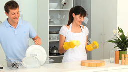 Cute couple washing up together Footage