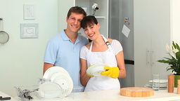 Couple washing up together Stock Video Footage