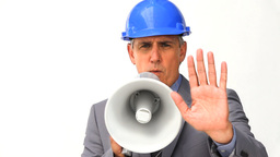 Businessman with safety helmet and megaphone Footage