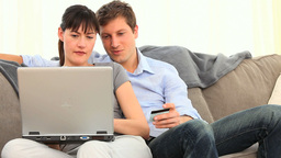 Pretty couple using a credit card on internet Footage