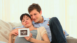 Attractive couple looking at a scan Footage