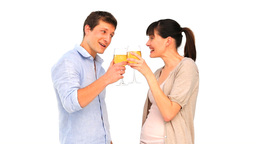 Attractive couple enjoying a glass of white wine Stock Video Footage