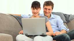 Happy young couple with a laptop Footage