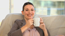 Businesswoman drinking a cup of tea Stock Video Footage