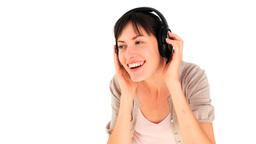 Happy woman dancing with headphones Stock Video Footage