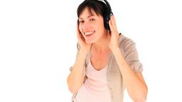 Happy woman dancing with headphones Footage
