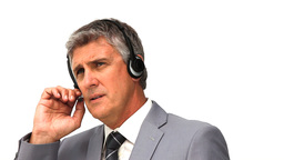 Businessman in grey suit speaking over the headset Footage