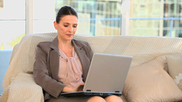Businesswoman working on a laptop Stock Video Footage