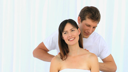 Man doing a massage to his wife Stock Video Footage