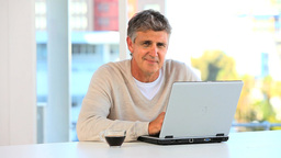 Casual man working on a laptop Stock Video Footage