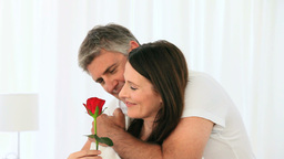 Cute middle aged couple with a flower Footage