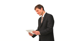 Young businessman using a touch pad Footage